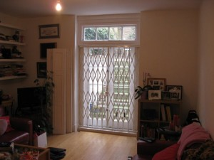 Collapsible door security grille wide shot