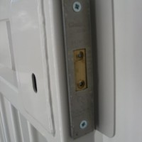 High security lever lock on a bar gate