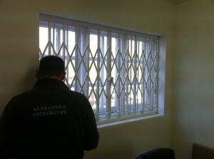 locksmith fitting internal collapsible security grilles