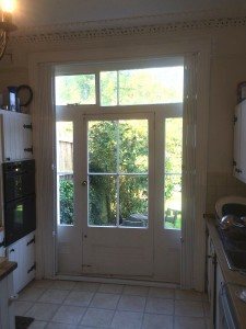 Collapsible security grille on a back door, fully open