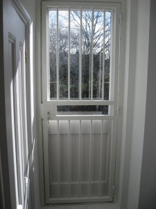 Interior fitted security bar gate